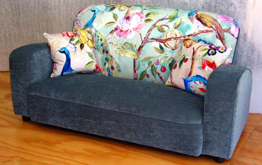 """""""feature-wall"""" in a sofa, accentuated with matching cushions - Living Room, Wellington"""