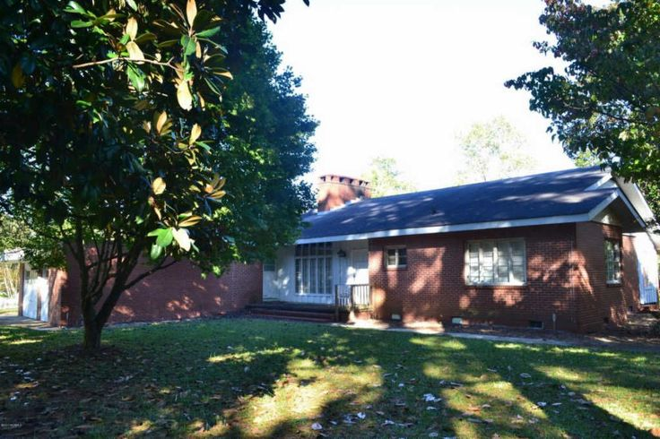 For sale: $95,900. 4 BR home with 2.5 baths, living room with fireplace, formal dining room, kitchen with breakfast nook and utility room.  Large sunroom.  Nice hardwood floors.  2 car garage.  Across from Plymouth Country Club. Corner lot.