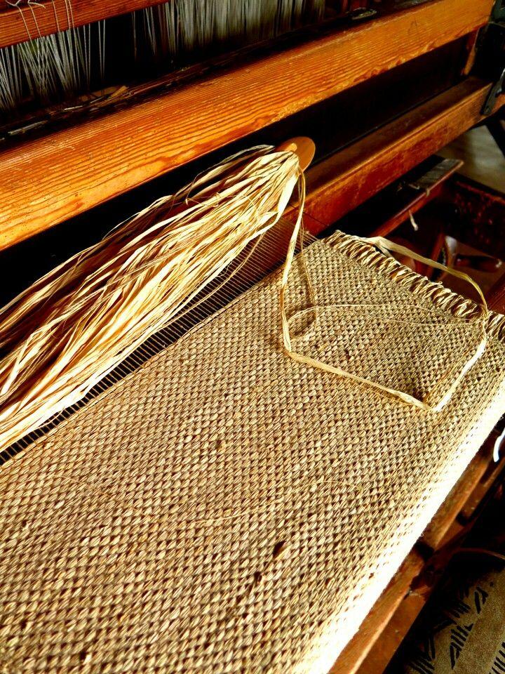 Raffia curtaining fabric being woven