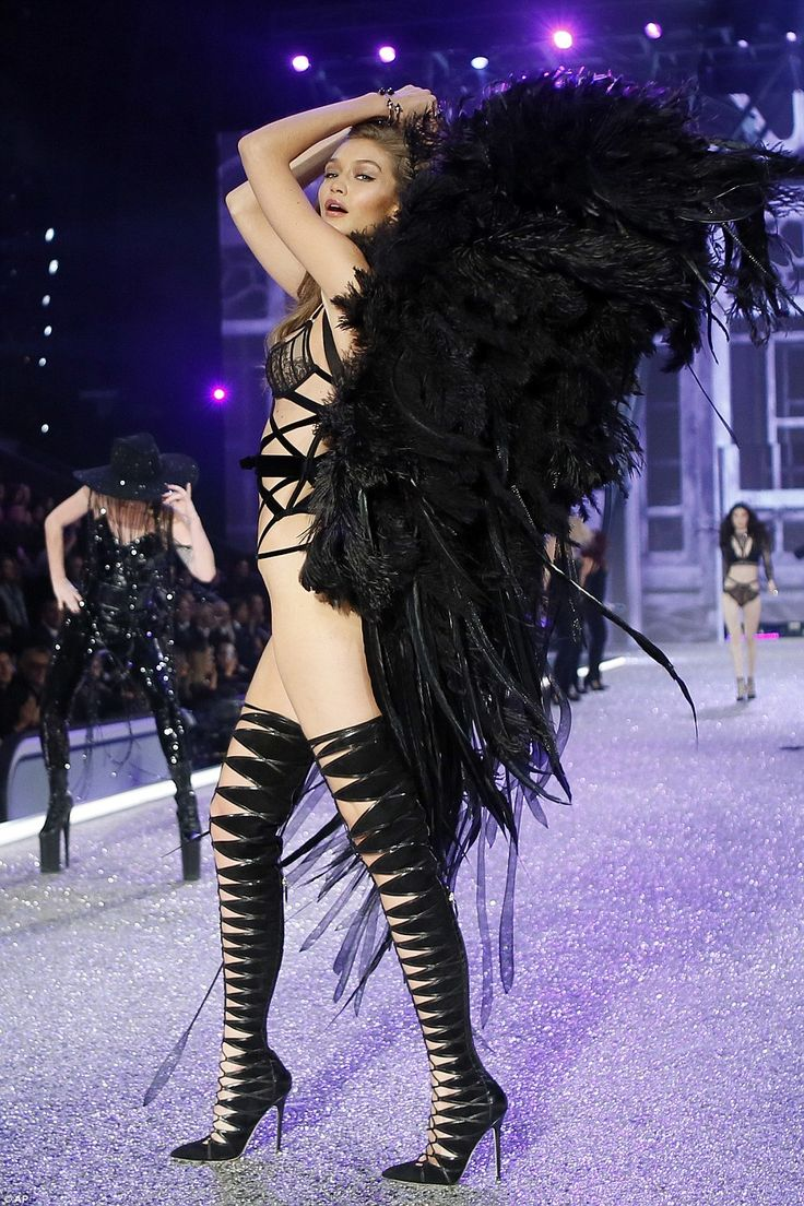 Flying high: The final touch to her seriously seductive ensemble was a pair of awe-inspiring angelic black feather wings that moved with the curves of her body