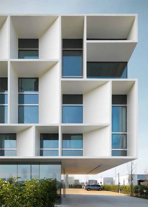 Beautiful brise soleil work on this apartment building. Nice way to add interest and movement that have a function.