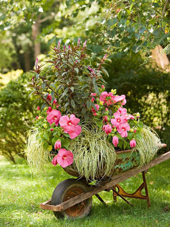 Reuse, Reuse - Retired garden gear makes a great addition to the garden. For an easy-to-plant whimsical landscaping design idea, roll an old wheelbarrow into a corner or curve in the garden, and plant it with a pretty collection of same-color flowers. The portable nature of the planter makes it possible to move to make the wheelbarrow even more of a focal point for special occasions, such as a garden party.