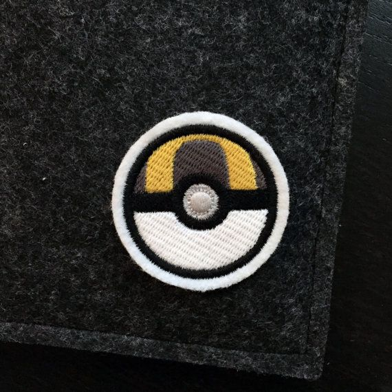 Got to catch them all! When youve capture your fair share of pokemon, this ultra ball patch will show everyone your love of the game. A premium patch embroidered with vivid colours on a durable felt base. It measures approximately 2.0 x 2.0  This patch can be sewn or ironed on to your favorite knapsacks, jeans or jackets. For removable options, choose our pin backed version that has a bar pin fastened to the back.