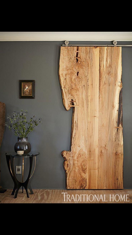 Zo'n enorm plak hout als schuifdeur voor de badkamer zou ik echt heel tof vinden!