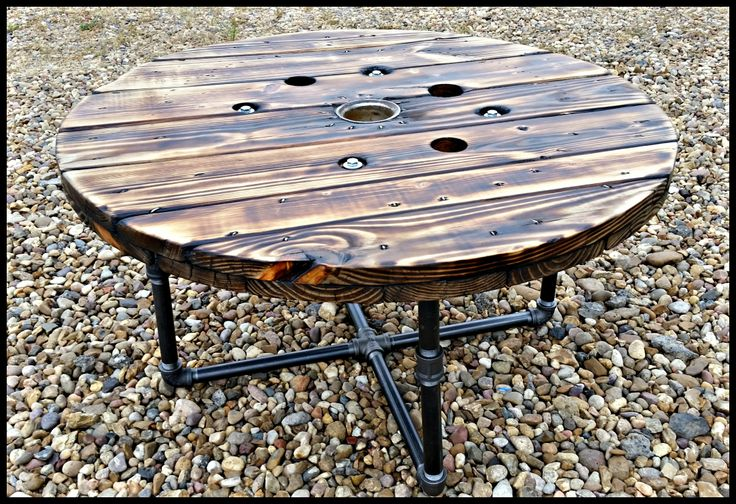 Repurpose industrial cable spool coffee table with piping base. Follow us for more wonderful pins at www.pinterest.com/3spurzdandc www.facebook.com/3SpurzDesignsAndCollectables www.3spurzdesignsandcollectables.com