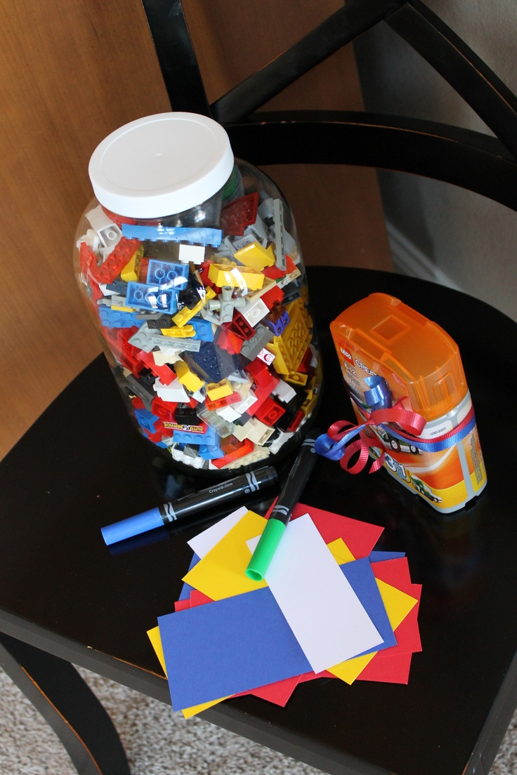 Lego  estimation guessing game. Put tons of legos in a glass jar and let the guests guess how many.  The best guess wins a Lego prize!