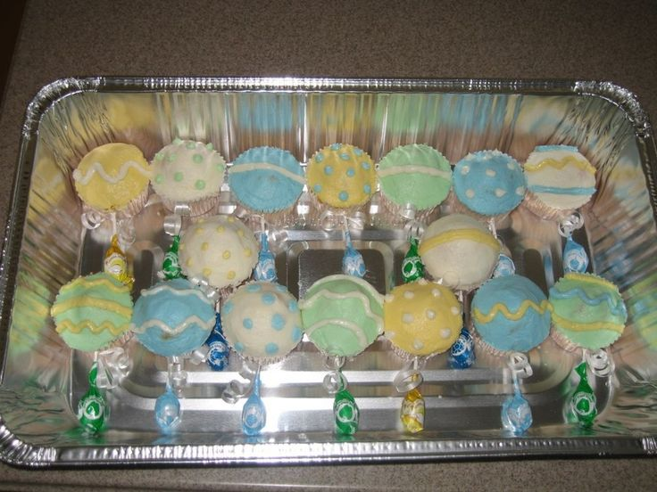 These are some baby rattle cupcakes that I made for a baby shower using BC and lollipops.