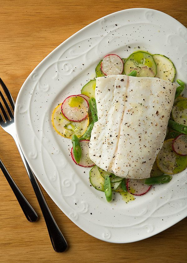 Butter poached halibut, with an early summer salad. Here's why you should add poaching in oil or butter to your bag of tricks. Recipe from Hunter Angler Gardener Cook.
