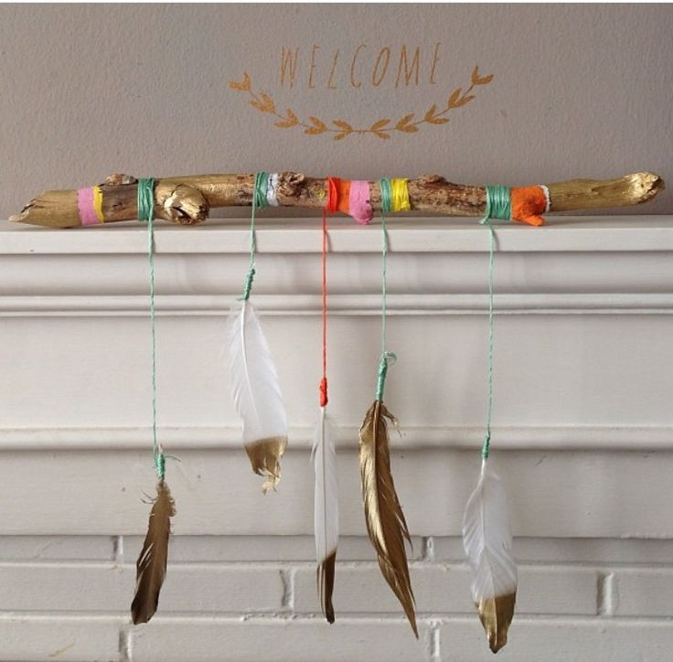 Stick, Yarn and feather decor