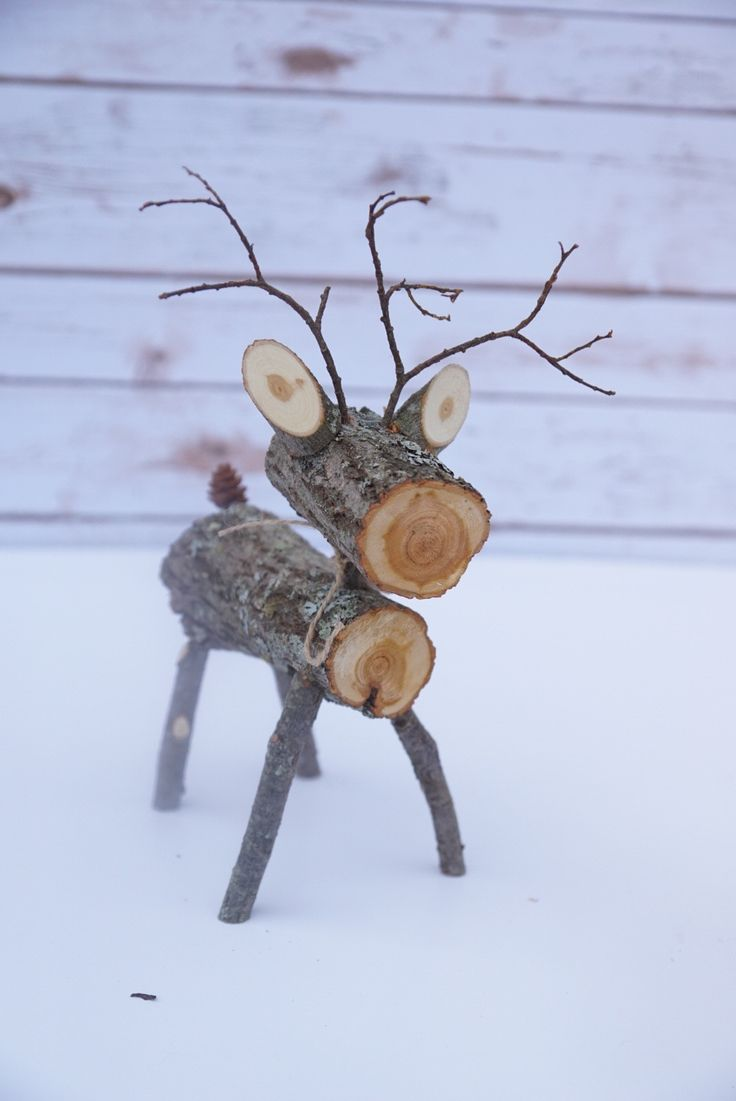 "These adorable wood log deer are perfect for your fall and winter decor. Each one is completely handmade from dried logs, sticks and branches from northern MN. They are approx 12"" tall and 7"" long. Th"