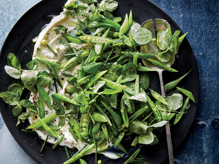 Snap Pea Salad with Whipped Ricotta | A gorgeous tangle of crunchy peas, leafy pea tendrils, and fresh herbs cascades over a creamy mixture of ricotta cheese and lemon zest. It's such a memorable salad that it will hold its own as the centerpiece of a meal. Serve alongside seared salmon fillets or sea scallops, grilled shrimp or chicken, or a slice of white pizza. Look for pea tendrils or shoots at your farmers market or Asian markets; if you can't find them, substitute watercress or…
