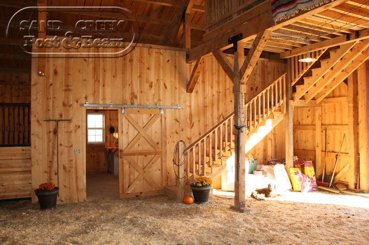Horse Barn Interior with loft    www.sandcreekpostandbeam.com  https://www.facebook.com/pages/Sand-Creek-Post-Beam-Traditional-Post-Beam-Barn-Kits/66631959179