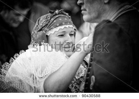 VRACOV - OCTOBER 15: Woman in folk costume arrange man on The biggest folk feast in Czech Republic, Oct 15, 2011 in Vracov, Czech Republic. ...