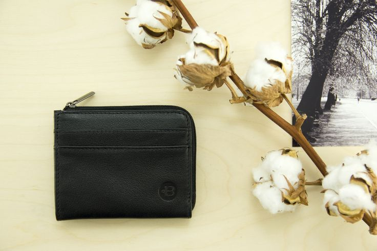 Small leather wallet with zip. This wallet has coin pouch. Small wallet that holds more rhen 30 cards