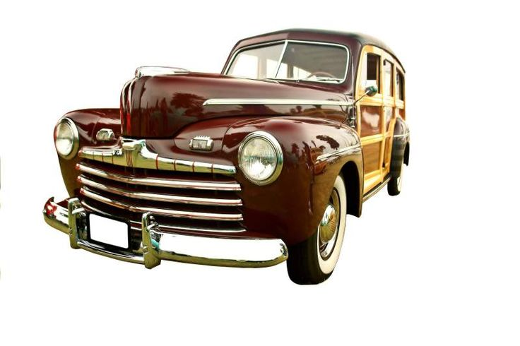 beautifully restored vintage woody station wagon, maroon