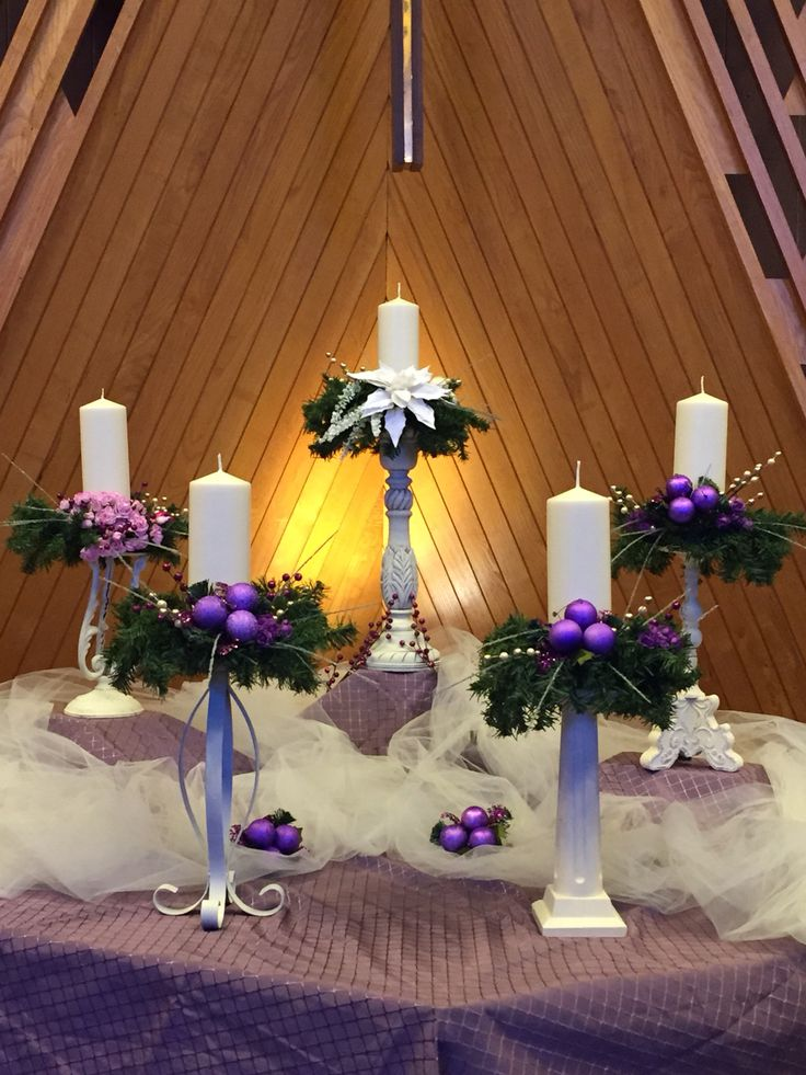 Advent altar 2015 Parkrose UMC. Altar decorated with white candles and flower decorated candle sticks of varying heights & styles in the colors of the season.
