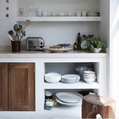 Built in shelves, looks like cement screeded countertop and like the wooden doors - probably just here and there, I like the open look of it.  Neat and clean =)