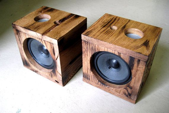 These are a one of a kind, unique and original pair of Home audio Surround L/R, Front and/or Bookshelf speakers.  These handmade, sturdy solid oak cases house a pair of speakers which project a clear, full range sound which can easily complement your surround sound or home theater system. Theyre especially great with a vinyl record player and offer a much more decorative look to the front or rear of your home theater system than big box store system speakers.  Specs: (2) 60 watt 5 Full…
