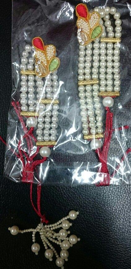 Pearl rakhi pair for bhaiya bhabhi, available at www.facebook.com /ppureppink