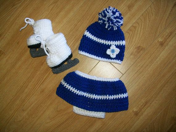 Baby Girl Costume  How cute and fun will your new little bundle look sporting her new skates for the party. Skirt has diaper cover attached. Hat with two big pompoms and of course her skates. Beautiful first time prop pictures of your little girl.