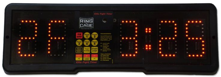 Elite Fight & Gym Digital Timer with Remote (Wall Timer). FIGHT TIMER is ideal for sporting activities and gymnasiums (competitions, training, fitness sessions) where the sequences of action-pause are of a fixed duration as in: Boxing, MMA, Brazilian Jiu Jitsu, Kickboxing, Taekwondo, Cross Fit, Spinning, Aerobics etc. Original Fight Timer, Designed and Made in ITALY. 2 Year Warranty. both wall and desk version timers come with remote. Travel case is available at extra cost. Power supply:...