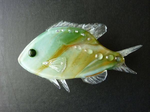 This fused glass fish is on display as part of a painting created for a local shop. This is the second in the series, and featured in Fired Arts & Crafts July 2013 issue.