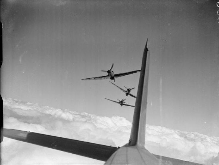 Three Hawker Hurricane Mark I's simulate an attack in line astern on the photographer's aircraft. France, 1939/1940