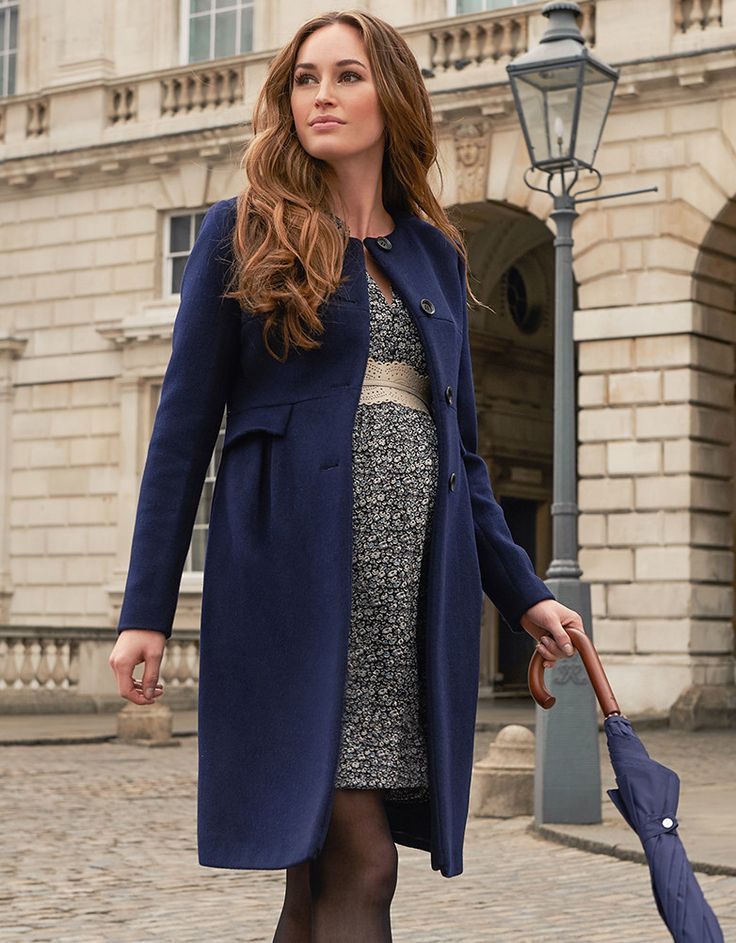 The style loved by the Duchess of Cambridge, our navy maternity coat is a true fashion classic. Made in a luxurious cashmere blend with clean lines and a sleek straight cut, this smart maternity coat offers a timeless look, which works perfectly before, during and after pregnancy. The understated collarless style is finished with smart faux-pockets at the empire waist and a classic button down front. Layer our long line coat over tailored maternity dresses for a stylish streamlined look.