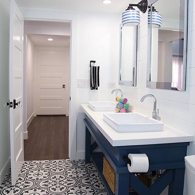 Our (finally) complete bathroom!  Side note: If you love the look of cement tile, but not the price... Check out Merola tile at Home Depot!…