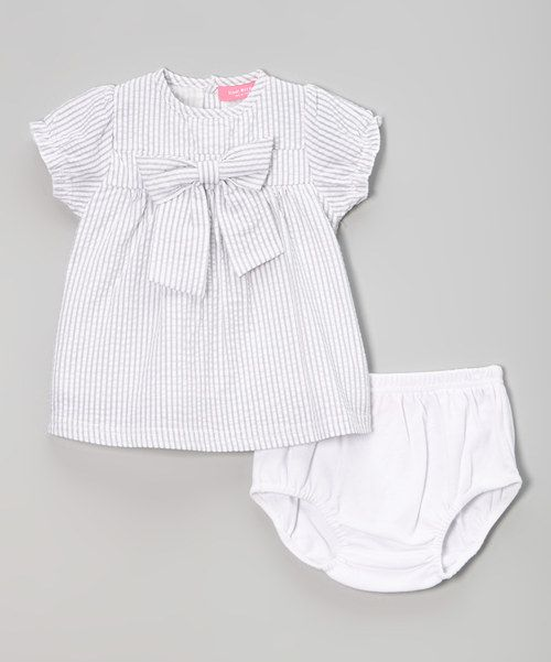 Little cuties can explore the world dressed in cozy cotton with this darling instant outfit. A bow embellishment adorns the dress, and an elastic hem on the diaper cover makes sure that little tushies stay covered.