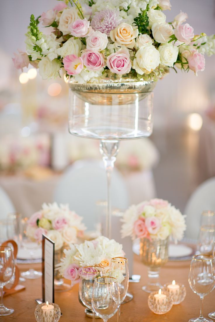 Tall and soft arrangements by Flowers in the foyer with golden touches. Photo by Ryan Graham