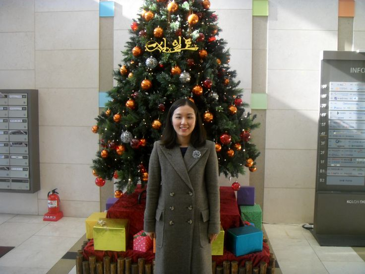 2015.12.13. After the church service in front of the church Christmas tree in the building.