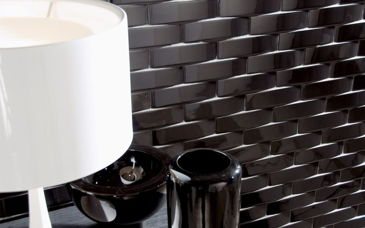 Collection: MUTINA Ceramica / Nera | A slight curve is all it takes to add texture and depth to a ceramic wall.