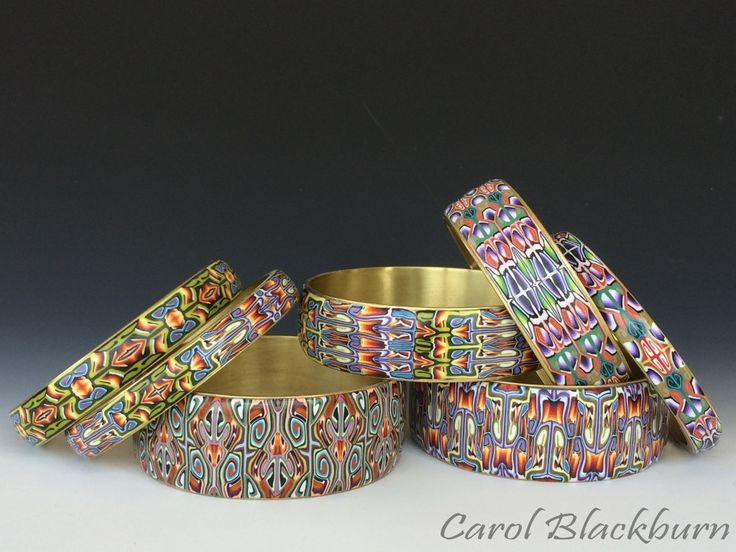 Carol Blackburn's stunning patterns. Here's hoping there is a new class on CraftArtEdu soon or that Carol comes to town. Just stunning.  https://flic.kr/p/nmjVSV | Bangles from Patterns in Polymer workshop |  IMG_3731_wm (1024x768)
