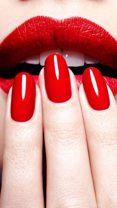Sexy nails, red nails, red lips.