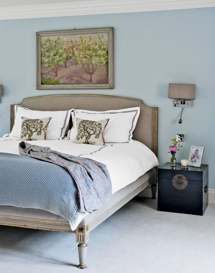 Pale blue and taupe bedroom with painting  - Oxfordshire house