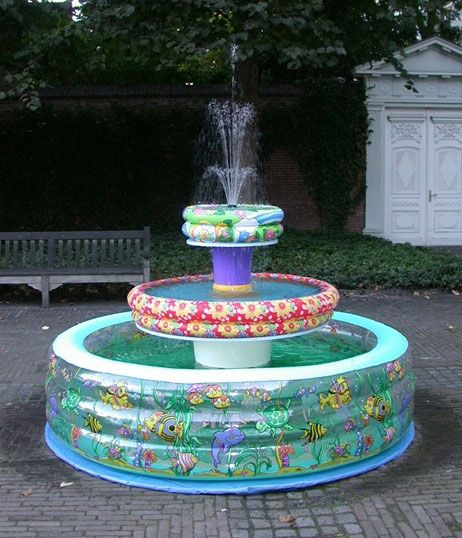 The Inflatable Swimming Pool Fountain. Shewt Dang the trailer park never looked so good!