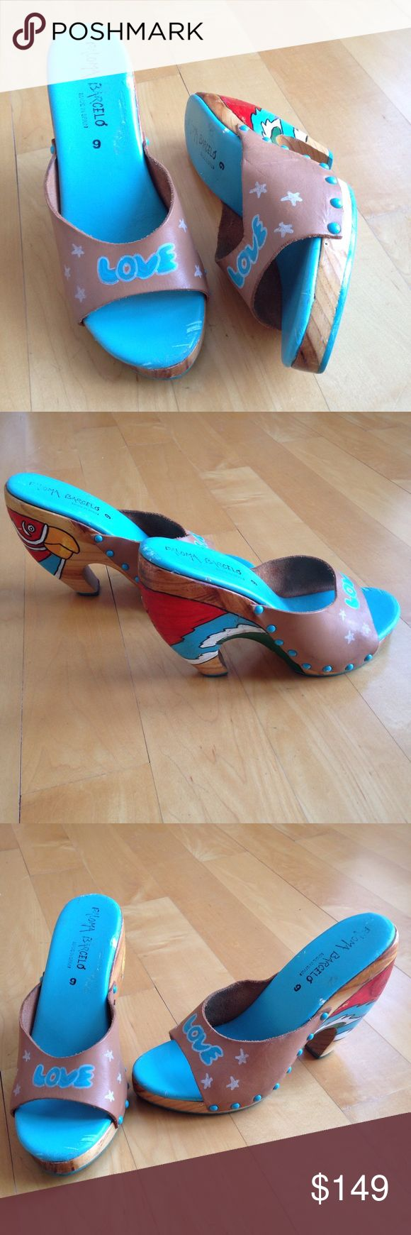 """Vintage Hand Painted Paloma Barcelo Wedges Made in Spain by high end designer Paloma Barcelo, they feature leather uppers that have been hand painted with white stars and the word """"LOVE"""", and the sole? They're genuine wood and have hand painted parrot heads. Great for Tiki Oasis, Hukilau, and any parrothead convention. Size is 9, but they run a tad small. I'm thinkin' they're best on an 8 or 8.5. They measure about 9-3/4"""" along the curve of the insole. And they're a whopping almost 5"""" high…"""
