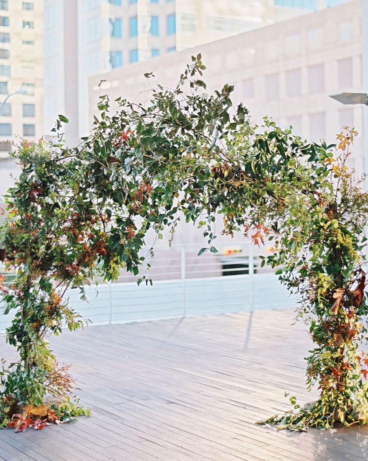 Just because you can't be married in nature doesn't mean you can't bring nature to you. This ceremony arch by @bowsandarrowsflowers is all the proof you need. Planning by @stefaniemiles, photo by @imryanray. #outdoorwedding #weddingceremony #weddingdecor