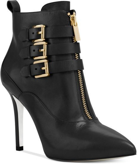 #michaelkors again! These sexy, edgy boots would never go out of style and worth the price tag! #fashion #booties