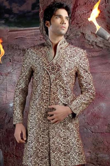 Gold shade sherwani with exquisite designs and patterns.