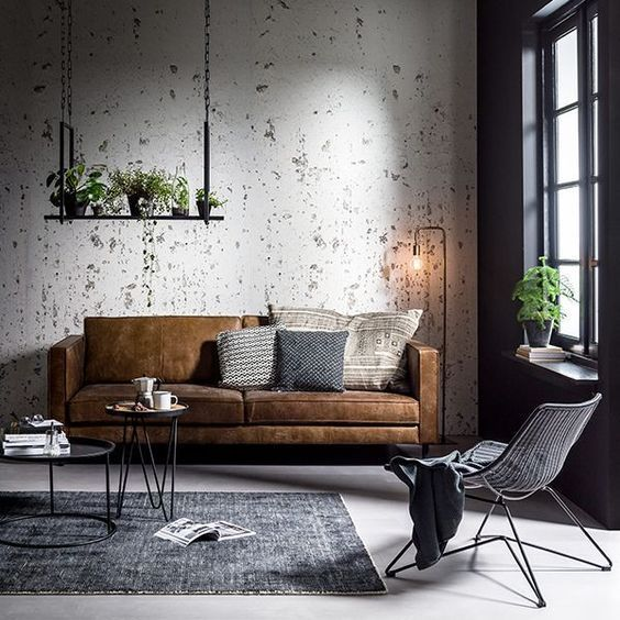 Modern Scandinavian Industrial Living Room With A Brown Velvet Couch And With Grey Detail Industrial Living Room Design Living Decor Industrial Interior Design