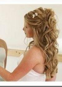 Tendance actuelle  coiffure de mariage cheveux long bouclés