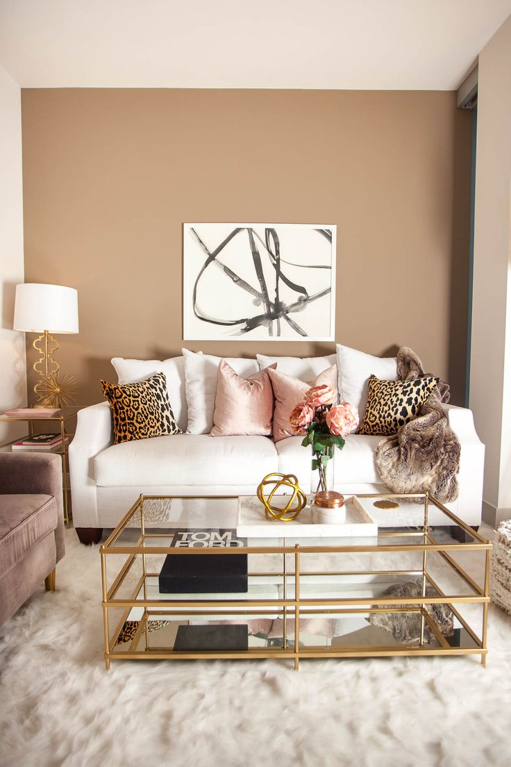 glam living room. gold accents with leopard print and pops of pink