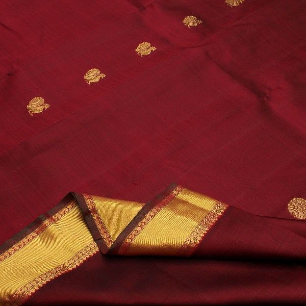 Golden peacock motifs appear to strut majestically across this rich maroon #Kanjivaram, in between two spinel red stripes embellished with paisleys and temple motifs. The striking pallu in a golden mustard shade is ablaze with vanki weaves and zari checks decorated with annapakshis and chakrams. A running blouse in the same mustard shade completes the classic look of this Sarangi #silk sari. For saris in this exotic colour, visit Sarangi. Code 540125912.