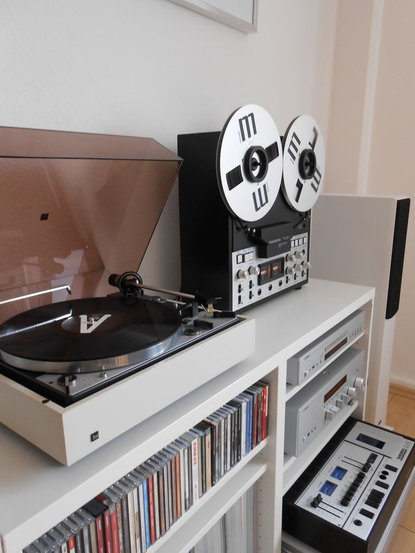 I really love the idea of having a music station in a central part of the house. Records and record player, CD's and CD player, an ipod loaded with all of your digital songs and an ipod dock, a great set of speakers.