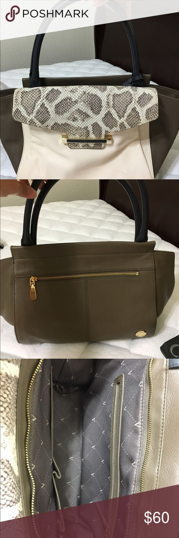 Vince Camuto Medium size bag Vince Camuto medium size bag.  Leather.  Gently used.  Only small minor stains that can be wipe clean easily as shown in picture.  Comes with dust bag. Vince Camuto Bags Satchels