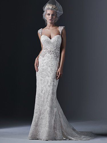 Sottero and Midgley - DEMETRIA, Elegant tulle and lace combine to create this stunning sheath wedding dress, accented with a Swarovksi crystal motif at the waist. Finished with dramatic sweetheart neckline and covered buttons over zipper and inner elastic closure. Beaded embroidered, cap-sleeve shoulder straps offered separately.
