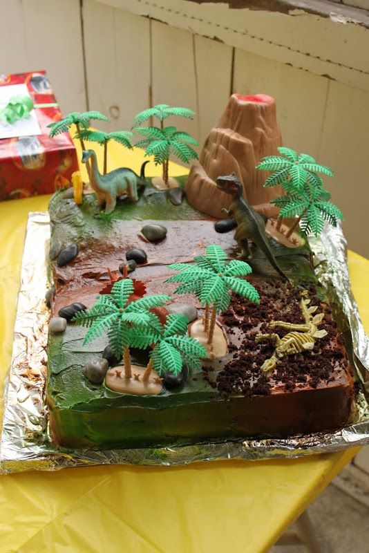 Dinosaur cake - Maybe could use green sugar sprinkled on chocolate frosting for a similar effect. The rock candies and cookie crumbles add nice detail.