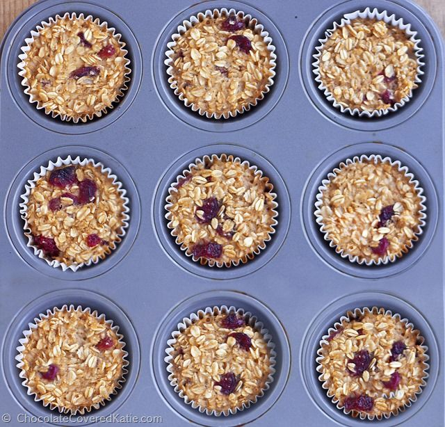 """These customizable """"breakfast"""" baked oatmeal cupcakes are great on-the-go fuel for those days when you have zero time in the morning to prepare a big meal. http://chocolatecoveredkatie.com/2015/01/08/go-breakfast-oatmeal-trail-mix-cupcakes/"""